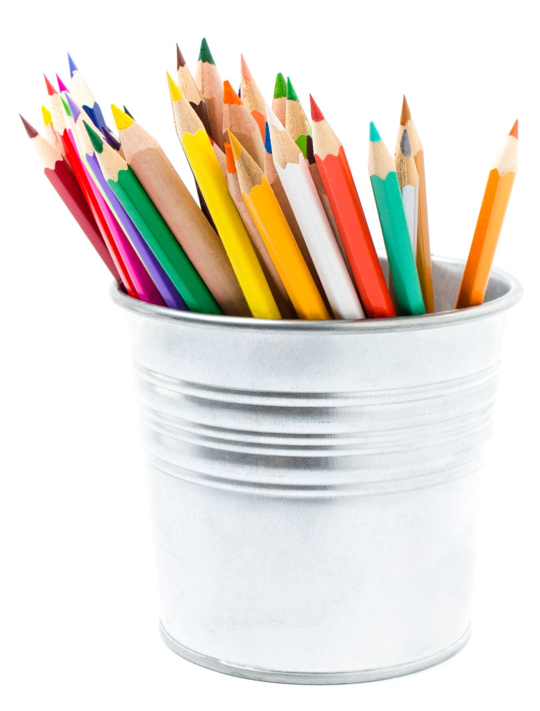 Color pencils in pencil holders isolated on white background, school supplies